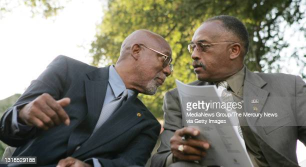John Carlos, left, and Tommie Smith, both San Jose State University alumni, 1968 Olympic medalists, and activists, talk as they wait for the...