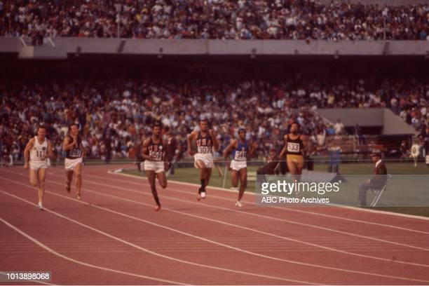 John Carlos, Tommie Smith competing in the Men's 200 metres event at the 1968 Summer Olympics / Games of the XIX Olympiad, Estadio Olímpico...