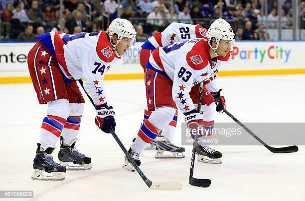 John Carlson and Jay Beagle of the Washington Capitals line up for a faceoff against the New York Rangers during a game at Madison Square Garden on...