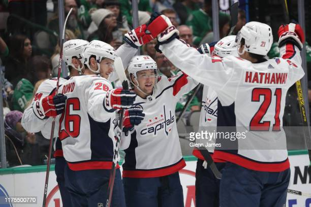 John Carlson Brendan Leipsic Nic Dowd and Garnet Hathaway of the Washington Capitals celebrate a goal against the Dallas Stars at the American...