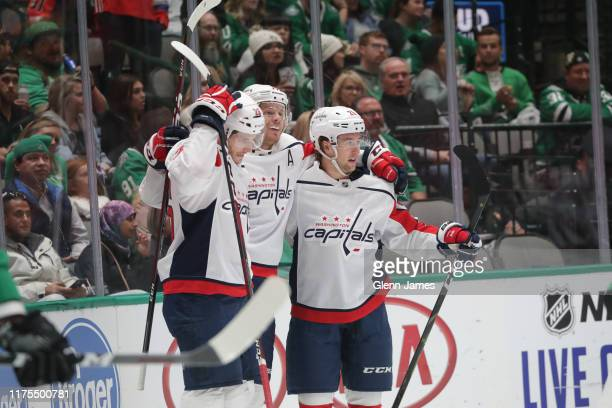 John Carlson, Brendan Leipsic, Nic Dowd and the Washington Capitals celebrate a goal against the Dallas Stars at the American Airlines Center on...