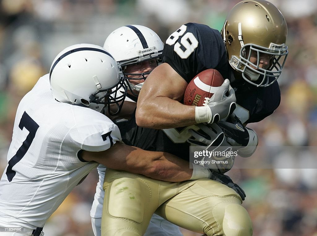 John Carlson #89 of the Notre Dame Fighting Irish is tackled by Anthony Scirrotto #7 of the Penn State Nittany Lions after a second quarter catch on September 9, 2006 at Notre Dame Stadium in South Bend, Indiana.