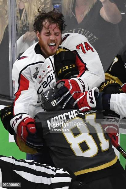 John Carlson of the Washington Capitals and Jonathan Marchessault of the Vegas Golden Knights fight after a secondperiod goal by Reilly Smith of the...