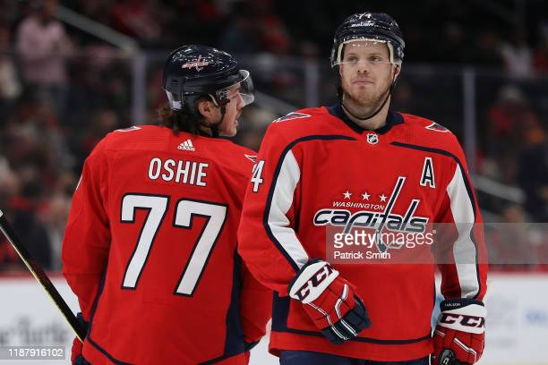 John Carlson of the Washington Capitals and T.J. Oshie of the Washington Capitals look on against the Montreal Canadiens during the first period at...