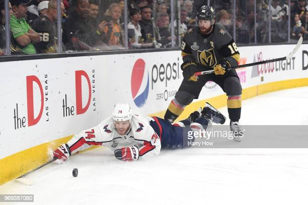 John Carlson of the Washington Capitals attempts to control the puck against James Neal of the Vegas Golden Knights during the first period in Game...