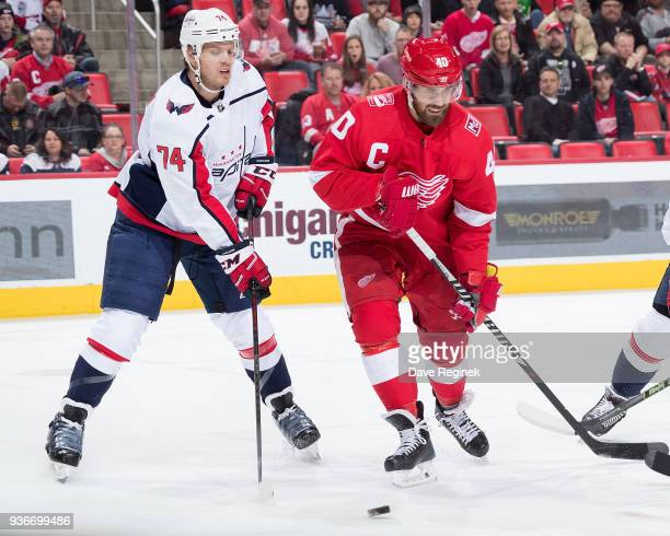 John Carlson of the Washington Capitals battles for the puck with Henrik Zetterberg of the Detroit Red Wings during an NHL game at Little Caesars...