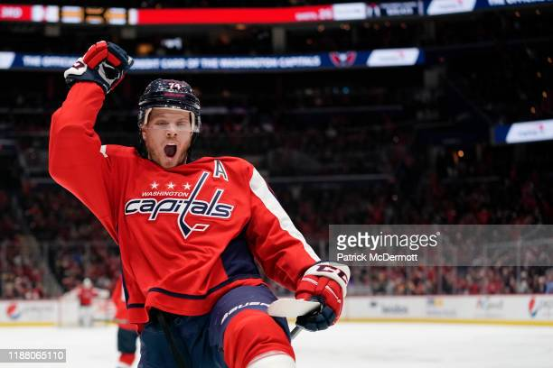 John Carlson of the Washington Capitals celebrates after scoring a goal in the third period against the Boston Bruins at Capital One Arena on...