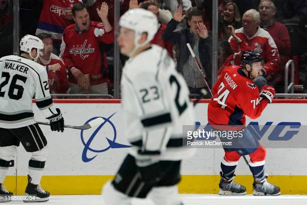 John Carlson of the Washington Capitals celebrates after scoring a goal against the Los Angeles Kings in the second period at Capital One Arena on...