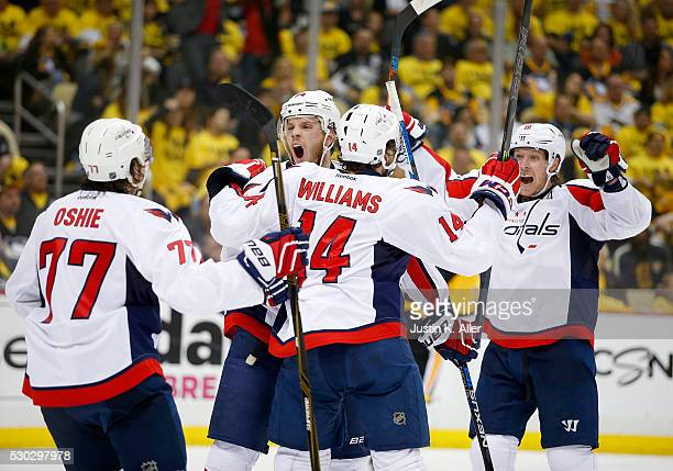 John Carlson of the Washington Capitals celebrates his third period goal against the Pittsburgh Penguins in Game Six of the Eastern Conference Second...