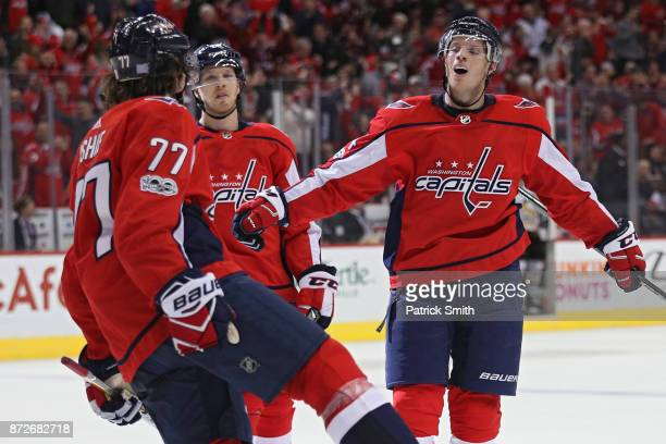 John Carlson of the Washington Capitals celebrates teammate TJ Oshie of the Washington Capitals goal against the Pittsburgh Penguins during the...