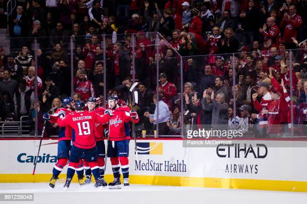 John Carlson of the Washington Capitals celebrates with his teammates after scoring a second period goal against the Colorado Avalanche at Capital...