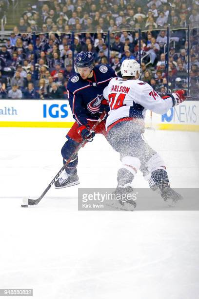John Carlson of the Washington Capitals checks Artemi Panarin of the Columbus Blue Jackets during the third period in Game Four of the Eastern...