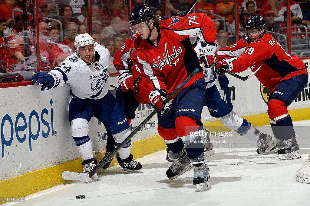 John Carlson #74 of the Washington Capitals controls the puck in the first period during an NHL game against the Tampa Bay Lightning at Verizon Center on April 13, 2014 in Washington, DC.