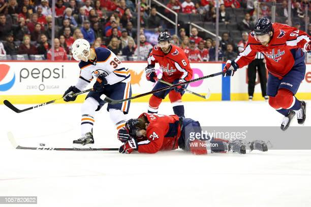 John Carlson of the Washington Capitals defends Alex Chiasson of the Edmonton Oilers during the first period at Capital One Arena on November 5 2018...