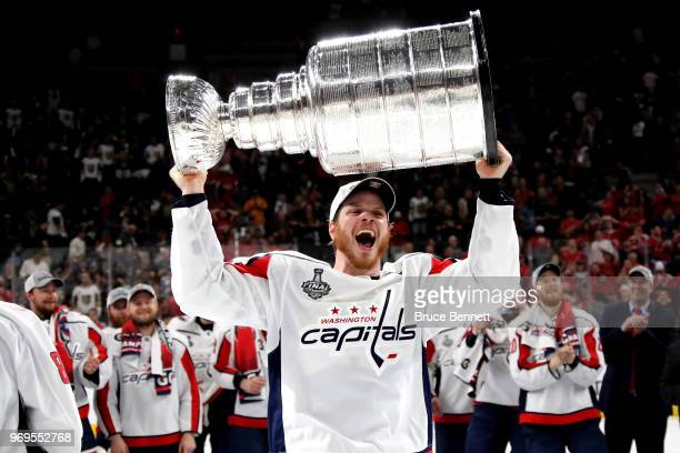 John Carlson of the Washington Capitals hoists the Stanley Cup after his team defeated the Vegas Golden Knights 43 in Game Five of the 2018 NHL...