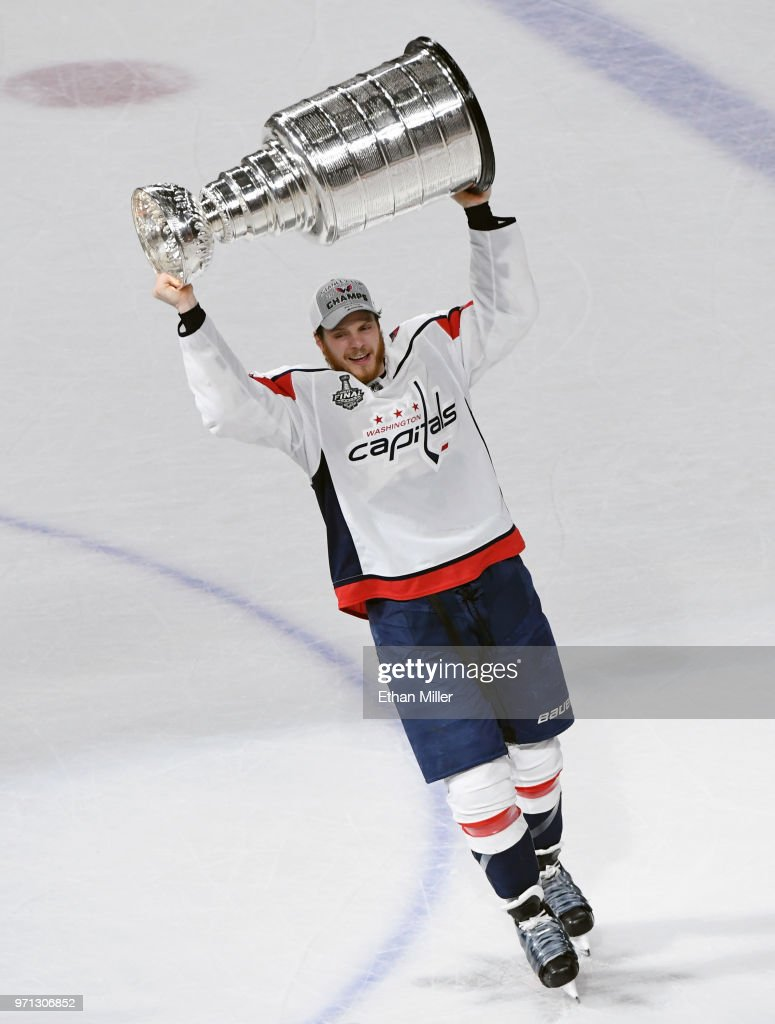 2a82aa4d2ca John Carlson of the Washington Capitals hoists the Stanley Cup after ...
