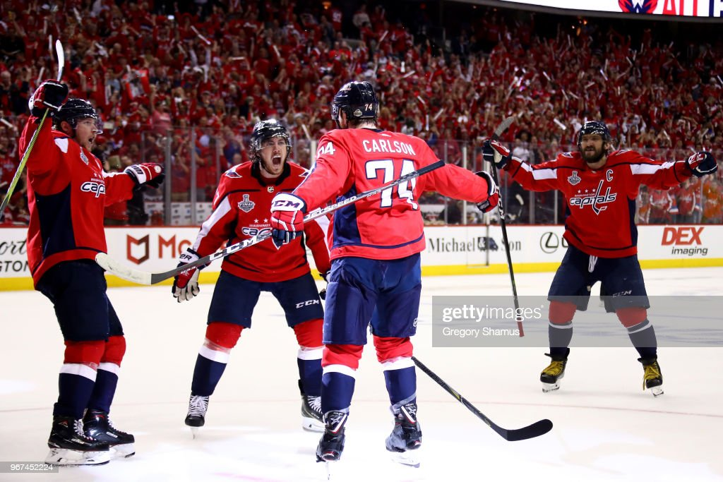 John Carlson #74 of the Washington Capitals is congratulated by his teammates after scoring a second-period goal against the Vegas Golden Knights in Game Four of the 2018 NHL Stanley Cup Final at Capital One Arena on June 4, 2018 in Washington, DC.