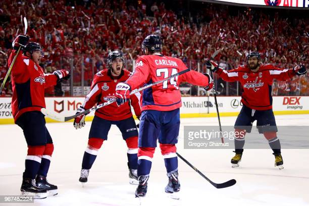 John Carlson of the Washington Capitals is congratulated by his teammates after scoring a secondperiod goal against the Vegas Golden Knights in Game...
