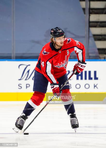 John Carlson of the Washington Capitals plays the puck against the New York Islanders during the first period in Game Two of the Eastern Conference...