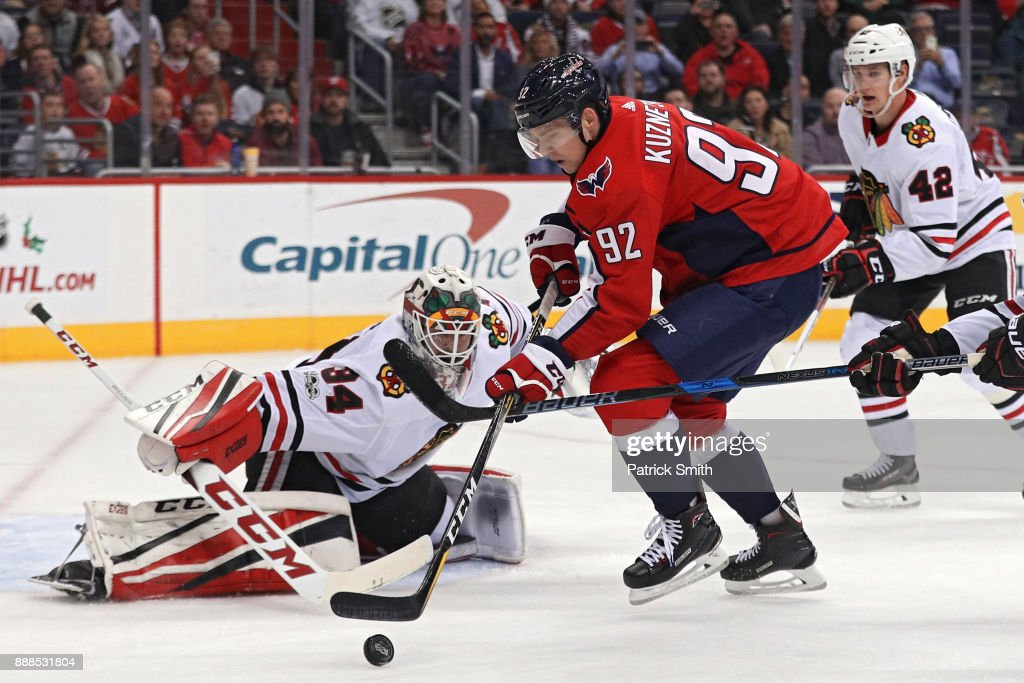 John Carlson #74 of the Washington Capitals shoots on goalie J.F. Berube #34 of the Chicago Blackhawks during the second period at Capital One Arena on December 06, 2017 in Washington, DC.