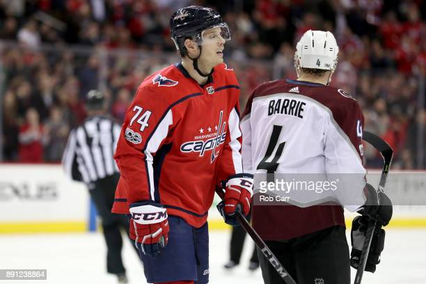 John Carlson of the Washington Capitals skates past Tyson Barrie of the Colorado Avalanche after scoring a second period goal at Capital One Arena on...