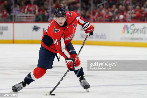 John Carlson of the Washington Capitals skates with the puck against the Winnipeg Jets in the third period at Capital One Arena on February 25, 2020...