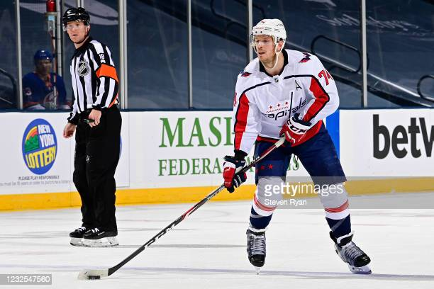 John Carlson of the Washington Capitals skates with the puck against the New York Islanders during the second period at Nassau Coliseum on April 22,...