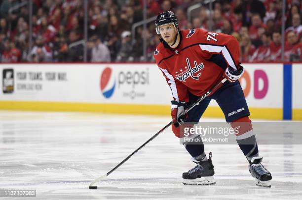 John Carlson of the Washington Capitals skates with the puck in the third period against the Winnipeg Jets at Capital One Arena on March 10 2019 in...
