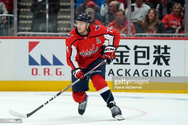 John Carlson of the Washington Capitals skates with the puck in the second period against the Dallas Stars at Capital One Arena on October 8, 2019 in...