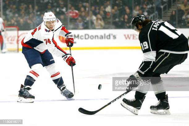 John Carlson of the Washington Capitals takes a shot as Alex Iafallo of the Los Angeles Kings defends during the first period at Staples Center on...
