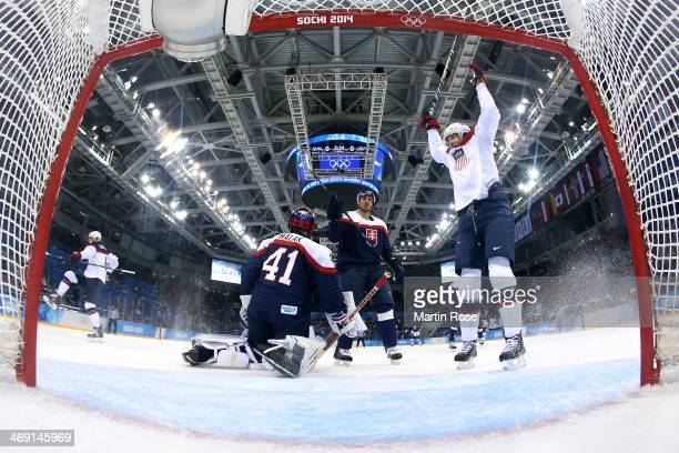 John Carlson of United States scores a goal against Jaroslav Halak of Slovakia in the first period during the Men's Ice Hockey Preliminary Round...