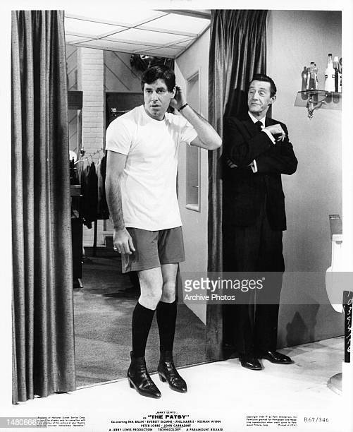 John Carradine grinning as Jerry Lewis comes out only wearing his underclothes in a scene from the film 'The Patsy' 1964