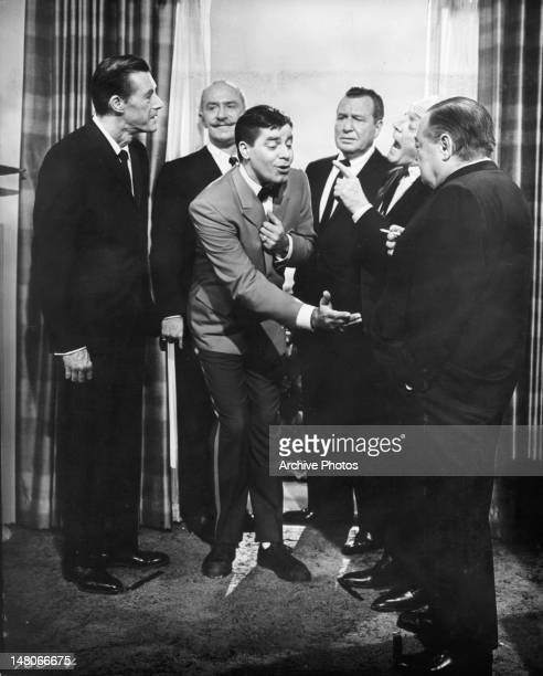 John Carradine Keenan Wynn Phil Harris Peter Lorre and others surrrounding Jerry Lewis in a scene from the film 'The Patsy' 1964