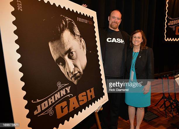 John Carter Cash and Executive Director Stamp Services Susan McGowan attend the Johnny Cash LimitedEdition Forever Stamp launch at Ryman Auditorium...