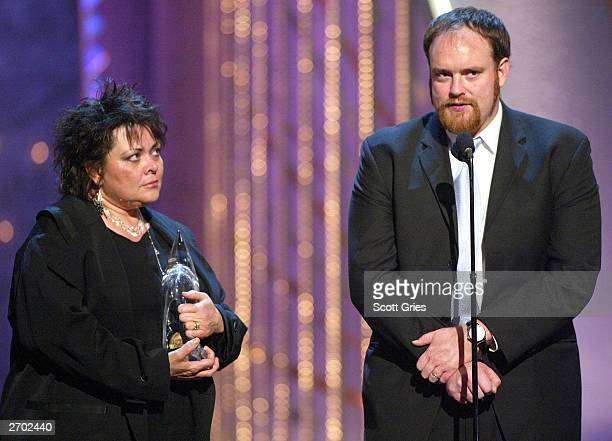 John Carter Cash and Kathy Cash accept an award for their father the late Johnny Cash at the 37th Annual CMA Awards at the Grand Ole Opry House...