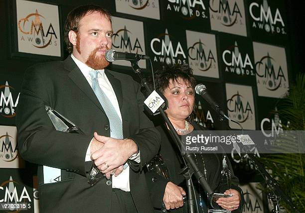 John Carter Cash and Kathy Cash pose with awards won by their father the late Johnny Cash backstage at the 37th Annual CMA Awards at the Grand Ole...