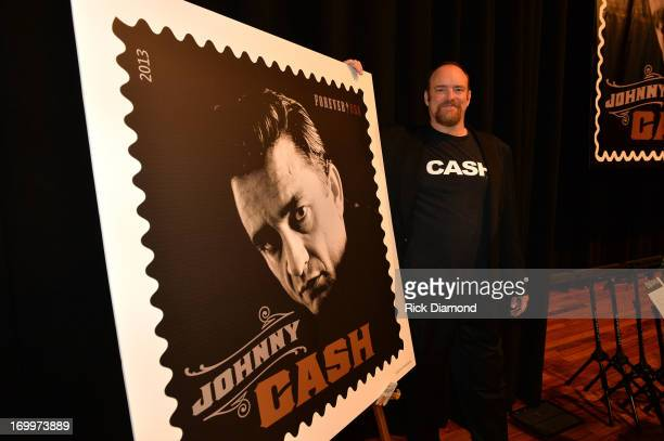 John Carter Cash attends the Johnny Cash LimitedEdition Forever Stamp launch at Ryman Auditorium on June 5 2013 in Nashville Tennessee