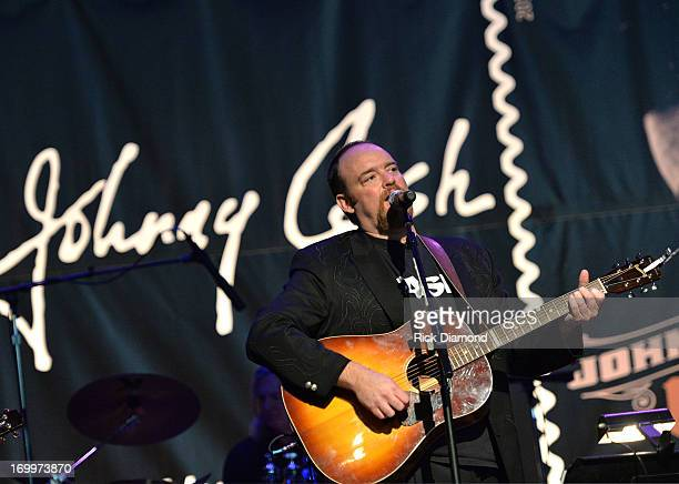 John Carter Cash performs at the Johnny Cash LimitedEdition Forever Stamp launch at Ryman Auditorium on June 5 2013 in Nashville Tennessee