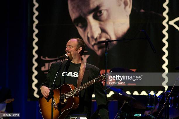 John Carter Cash plays the Johnny Cash LimitedEdition Forever Stamp launch at Ryman Auditorium on June 5 2013 in Nashville Tennessee