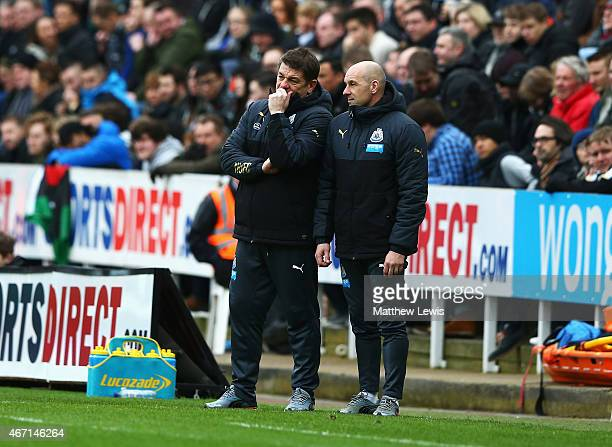 John Carver, manager of Newcastle United and Steve Stone talk during the Barclays Premier League match between Newcastle United and Arsenal at St...