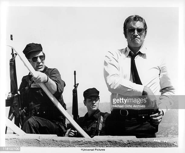 John Cassavetes and Charlton Heston close in on the sniper in a scene from the film 'TwoMinute Warning' 1976