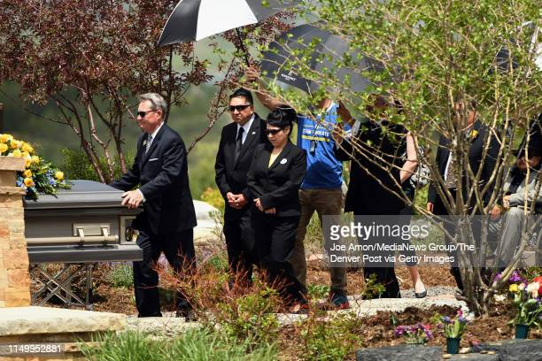 John Castillo and his wife Maria follow the casket of their son Kendrick Castillo who was killed during the STEM School Highlands Ranch shooting at...