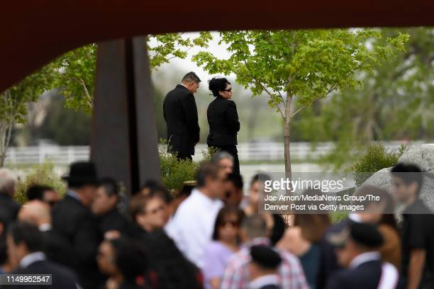 John Castillo and his wife Maria walk from the grave site as they laid to rest their son Kendrick Castillo who was killed during the STEM School...