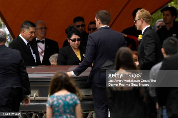 John Castillo and his wife Maria walk past the casket as they lay to rest their son Kendrick Castillo who was killed during the STEM School Highlands...
