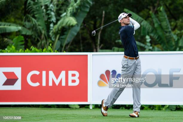 John Catlin of the United States plays his shot on the second tee during round three of the CIMB Classic at TPC Kuala Lumpur on October 13 2018 in...