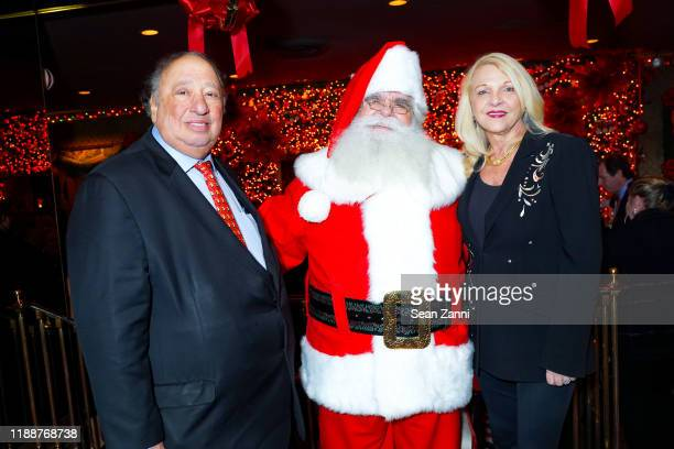 John Catsimatidis Santa Claus and Margo Catsimatidis attend Anne Hearst McInerney Jay McInerney And George Farias Host Christmas Cheer at Doubles...