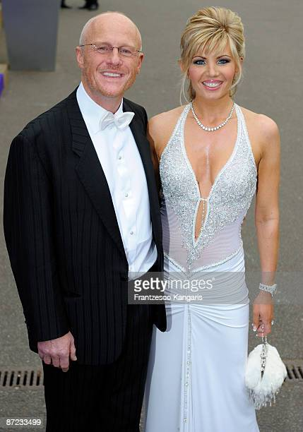 John Caudwell and Claire Johnson arrive at The Caudwell Children Butterfly Ball at Battersea Evolution on May 14 2009 in London England