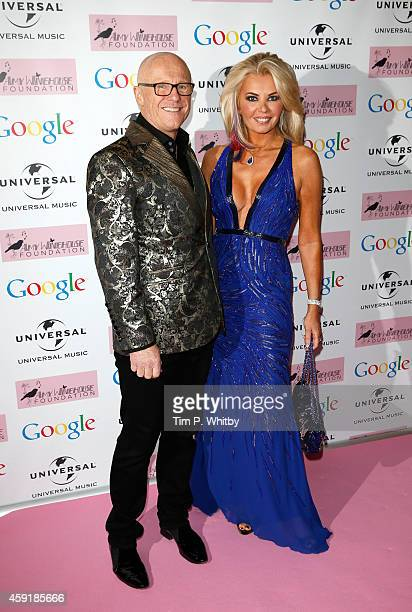 John Caudwell and Claire Johnson attend the Amy Winehouse Foundation Ball at The Landmark Hotel on November 18 2014 in London England
