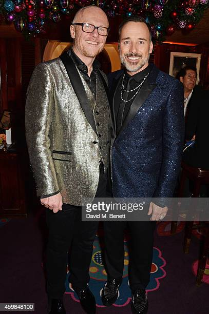 John Caudwell and David Furnish attend the Chopard Christmas Party at Annabel's on December 2 2014 in London England