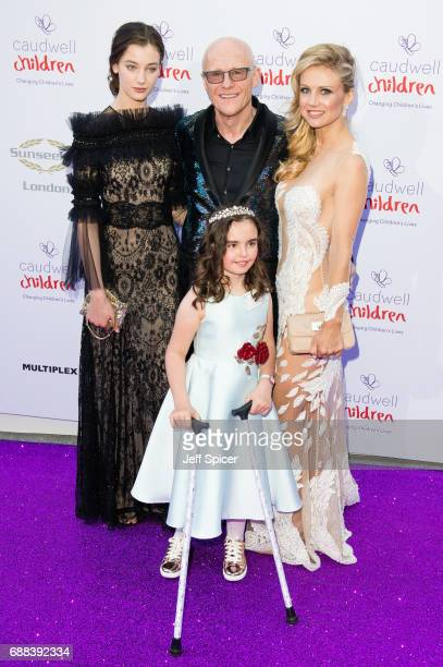 John Caudwell and Modesta Vzesniauskait attend the Caudwell Children Butterfly Ball at Grosvenor House on May 25 2017 in London England